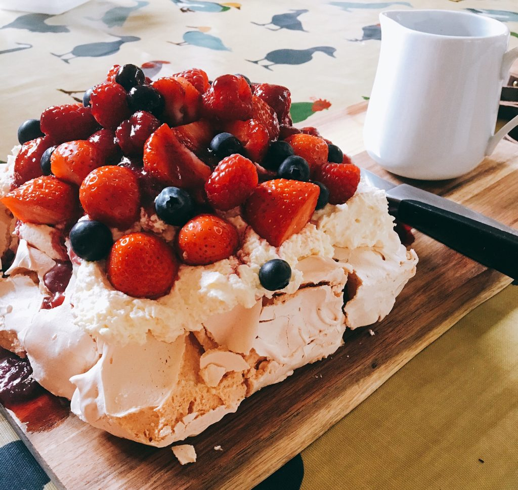 Lytes Cary Manor Personal chef pavlova with mixed berries berry sauce and vanilla cream