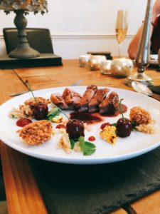 Duck Breast with red wine sauce, cherries, cherry fluid gel, confit duck leg bon bons, buckwheat and watercress with charred sweetcorn