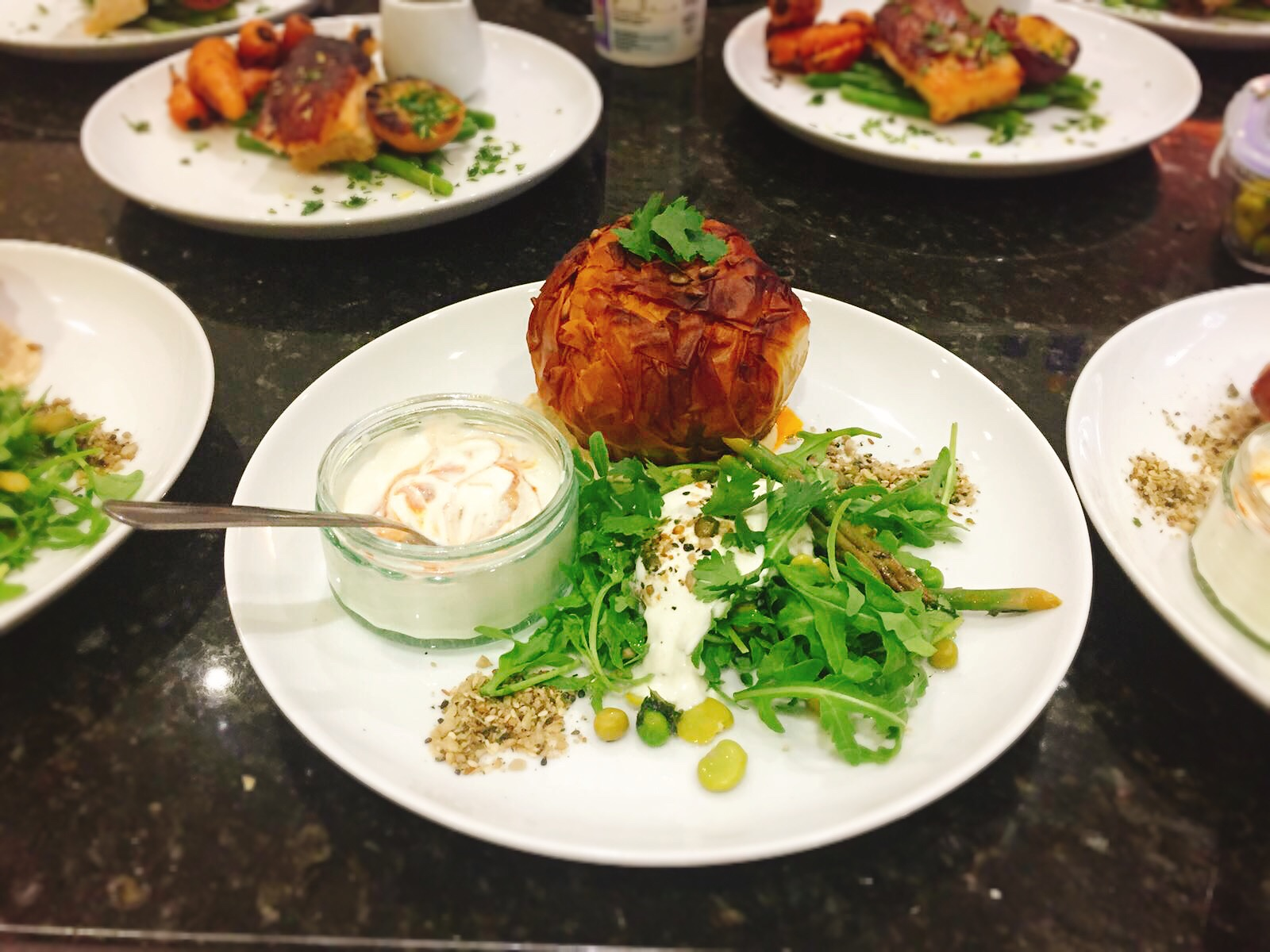 hen party catering Moroccan butternut squash filo pie with hummus, dukkah, harissa spiced yoghurt and broad bean, asparagus and rocket salad