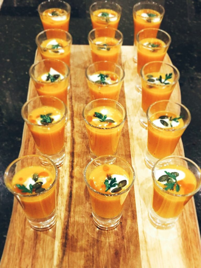 butternut squash veloute, hen party catering with parsley crisp, oat creme fraiche and pumpkin seeds