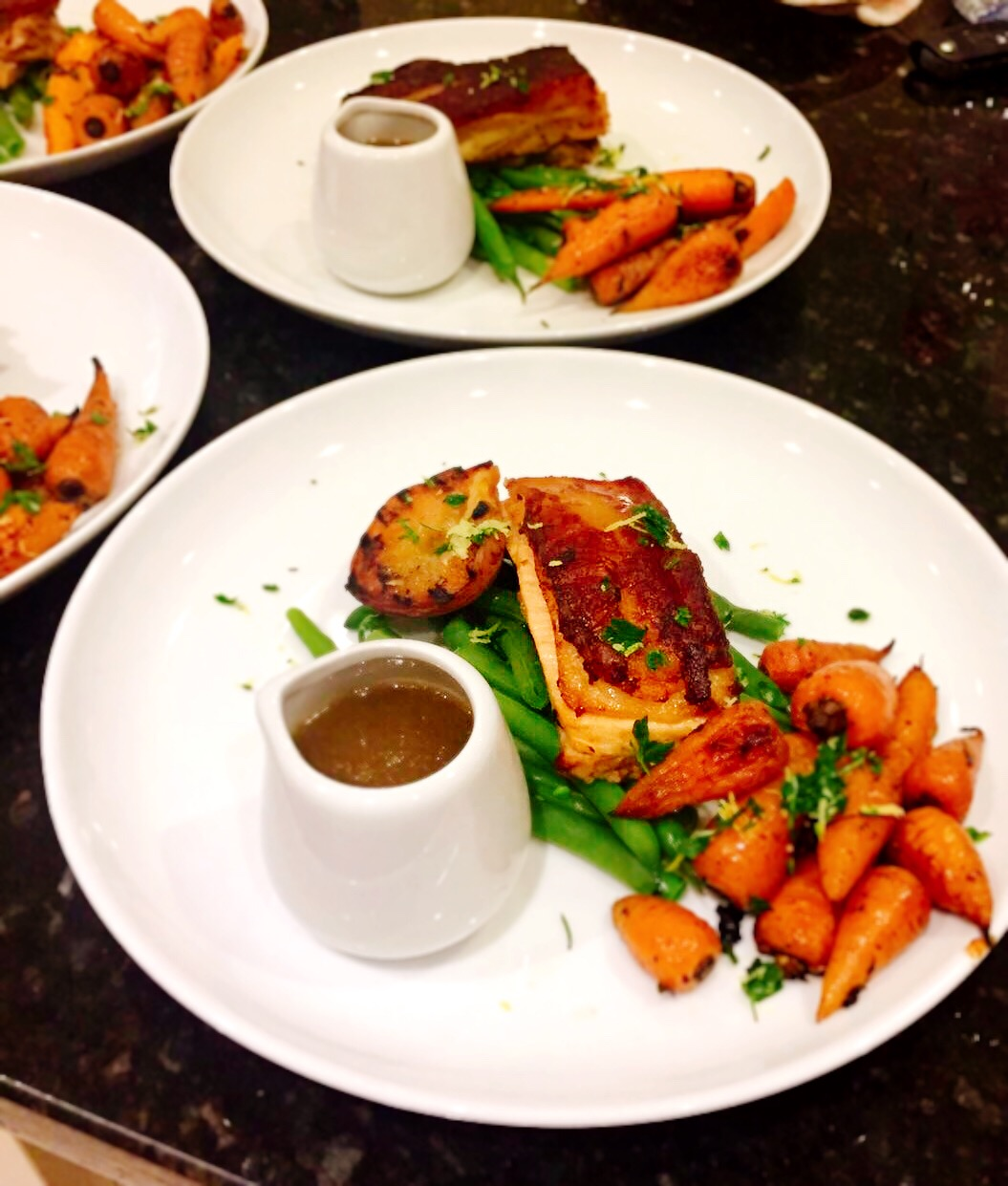 cider marinated pork belly with thyme roasasted carrots, green beans, salt and pepper roasted peach, gremolata and cider sauce