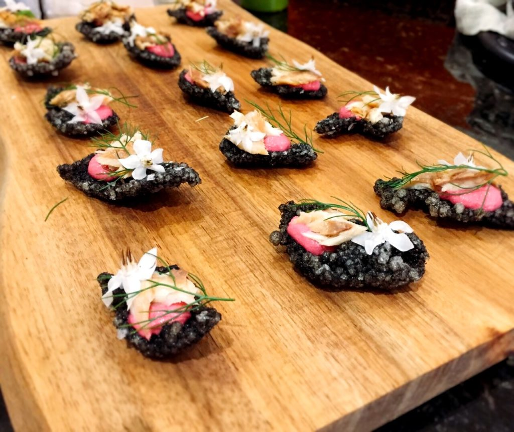 squid ink tapioca crisp with beetroot hummus, borage flower, fennel, smoked mackerel