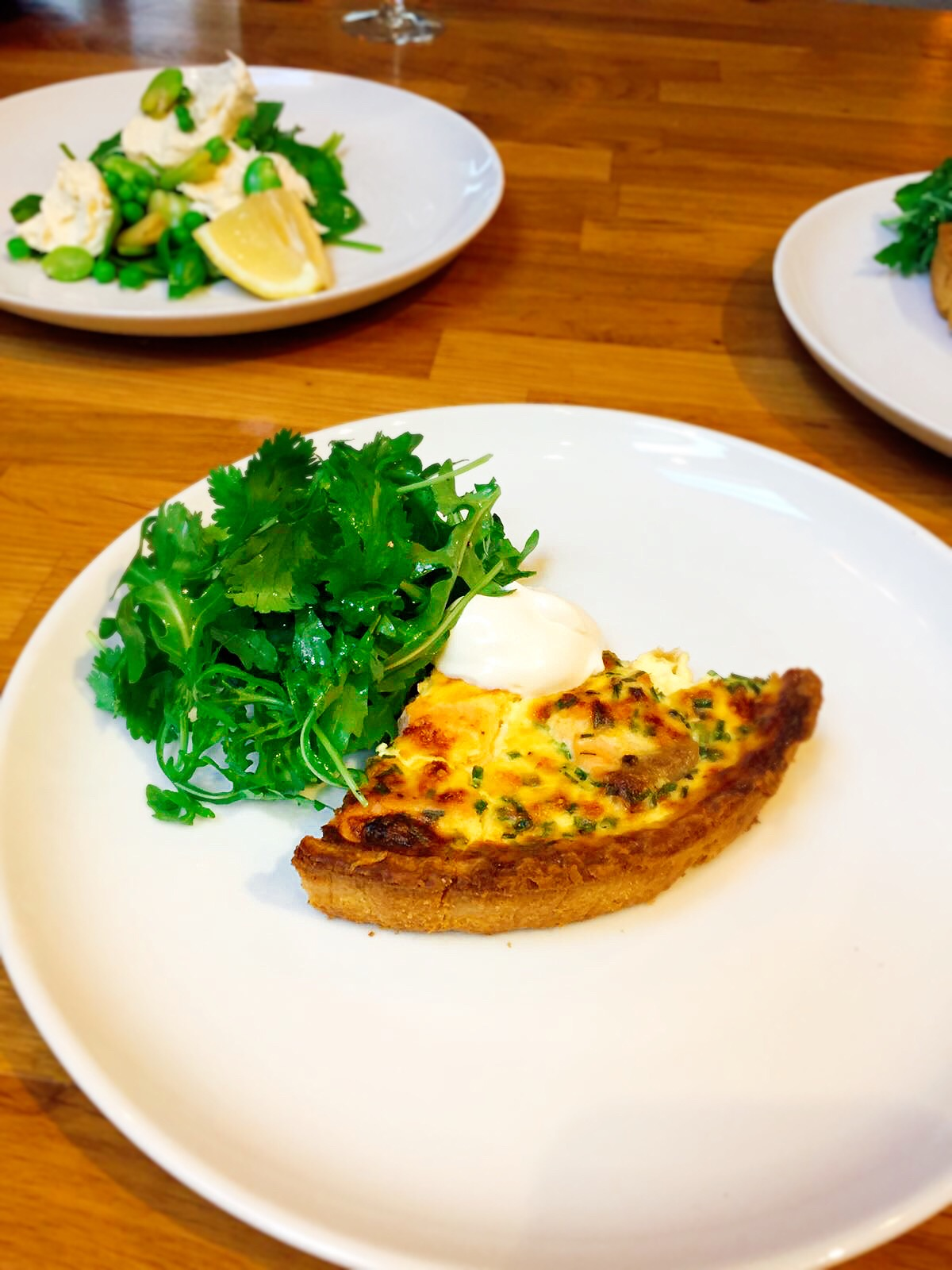 salmon and cheddar tart with corriander and rocket salad