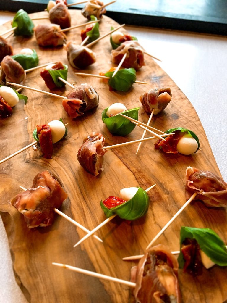 dolcelatte stuffed figs wrapped in prosciutto with sundried tomato mozarella and basil skewers personal chef Steve James Somerset Dorset Caterer