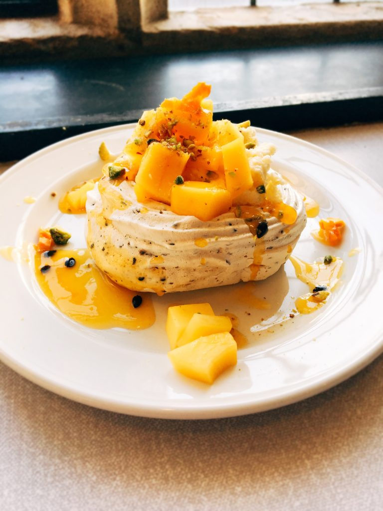 mango and passionfruit meringue with white chocolate cream and pistachio nuts personal chef Steve James Somerset Dorset Caterer