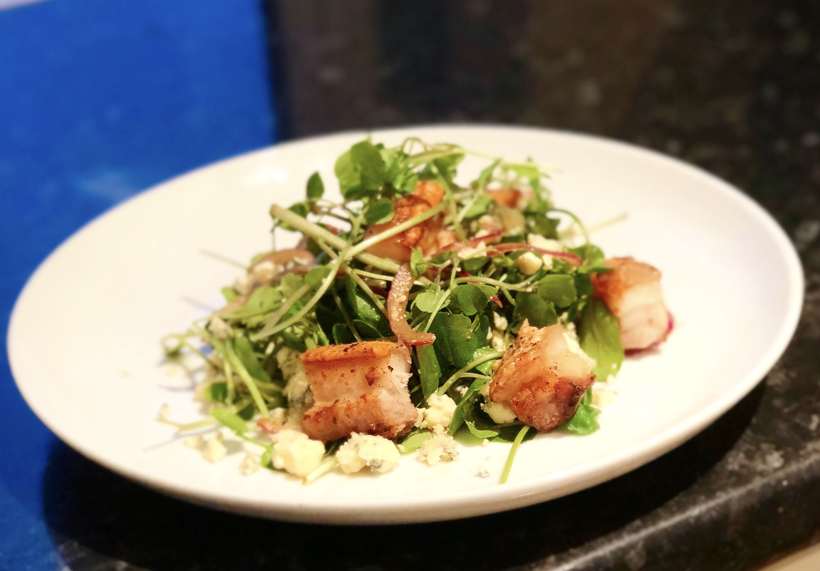 Salt and pepper pork belly with watercress, blue cheese and pickled red onion salad